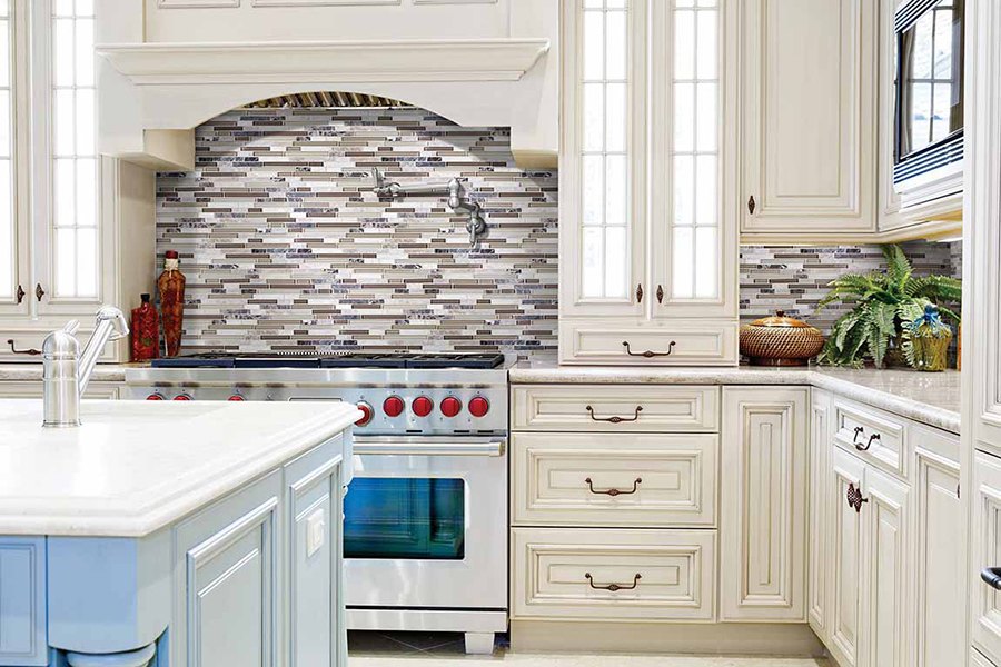 Kitchen backsplash made with neutral toned tiles